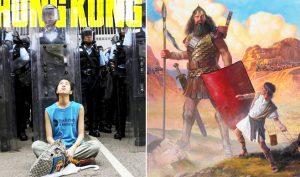 Những người biểu tình Hồng Kông tay không tấc sắt, đứng cầm dù đối mặt với phía cảnh sát được trang bị toàn bộ vũ trang khiến người ta liên tưởng đến câu chuyện của ba ngàn năm trước. (Ảnh: TH)